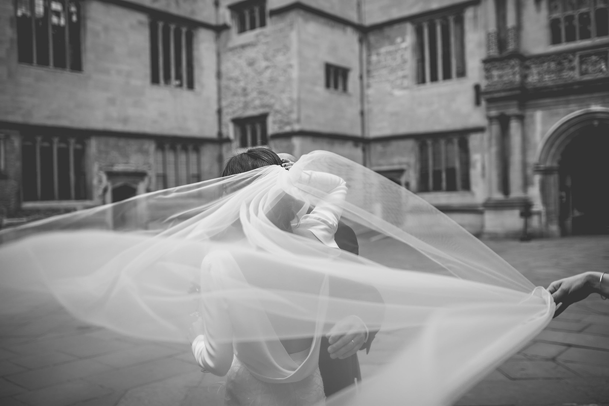 veil swirling around wedding photography