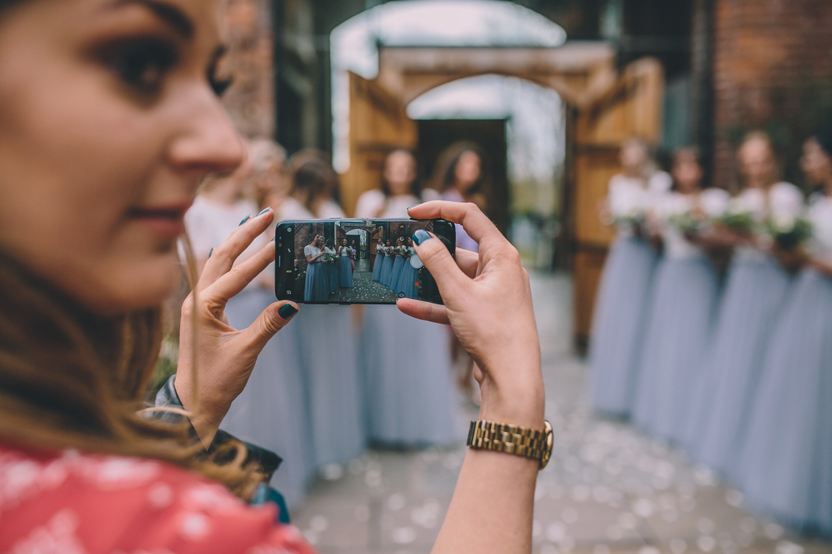 guest photographing bridesmaids wedding photography
