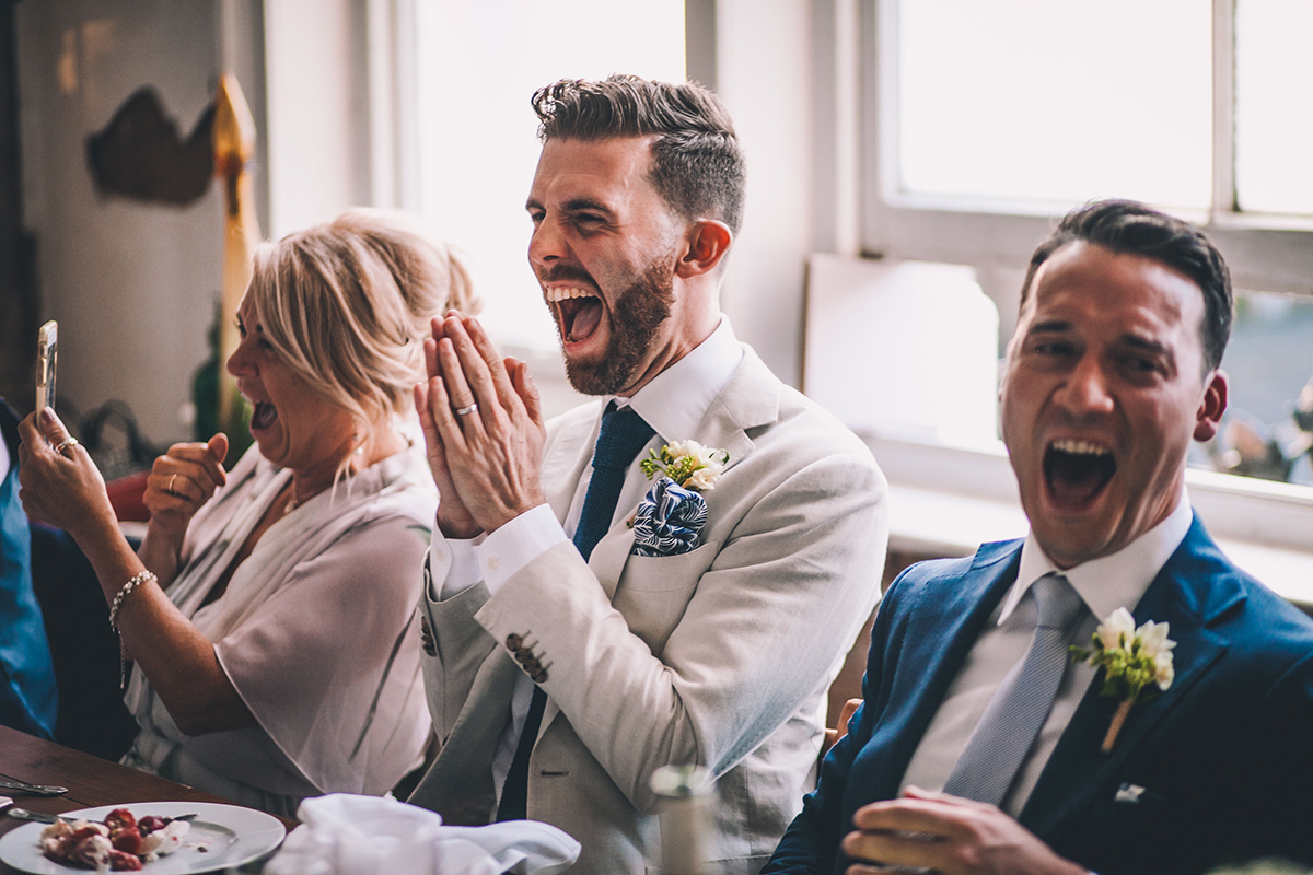 laughing at speeches gay wedding photography