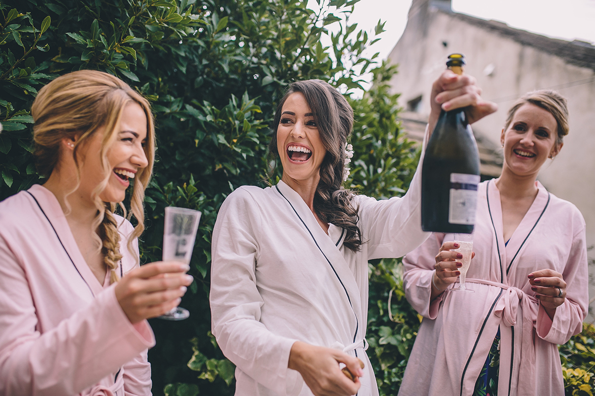 bridemaids with champagne wedding photography