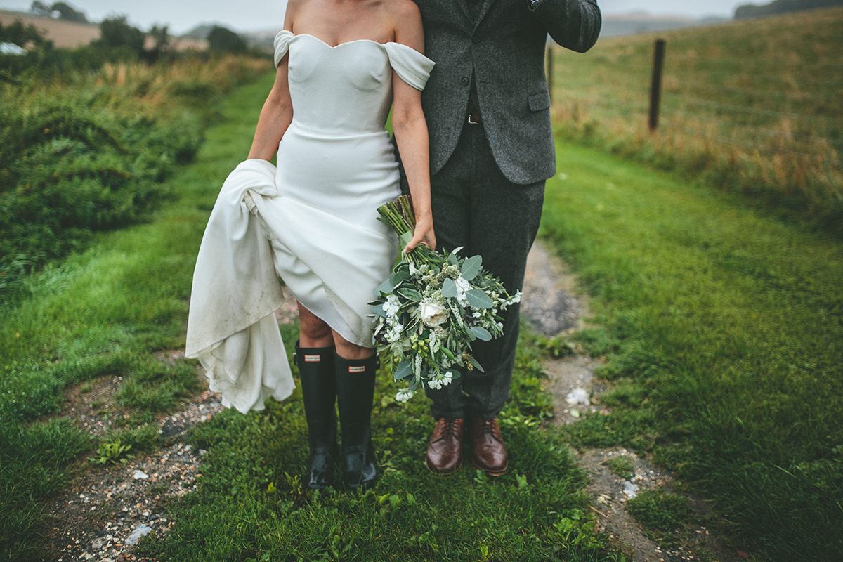 bride in wellies upwaltham barn wedding photography