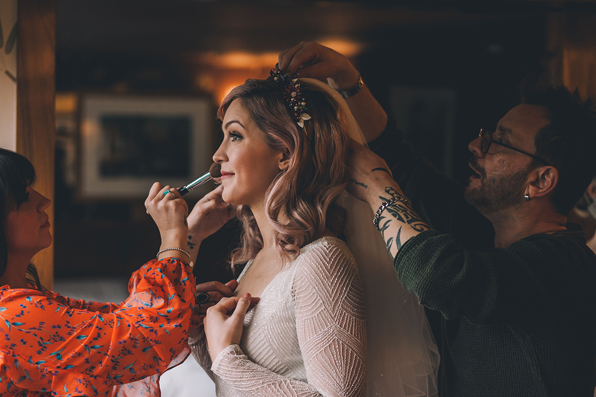 bride with make up artist wedding photography