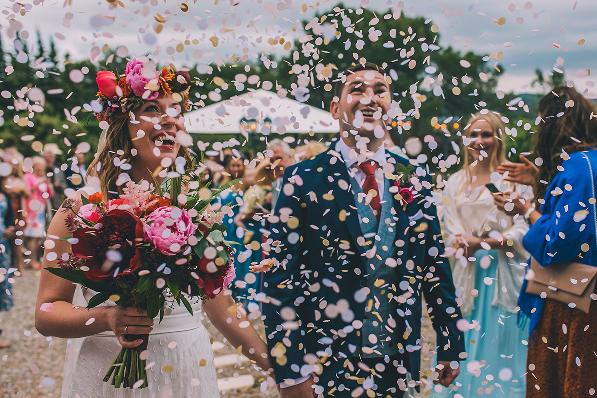 couple in confetti shower wedding photography