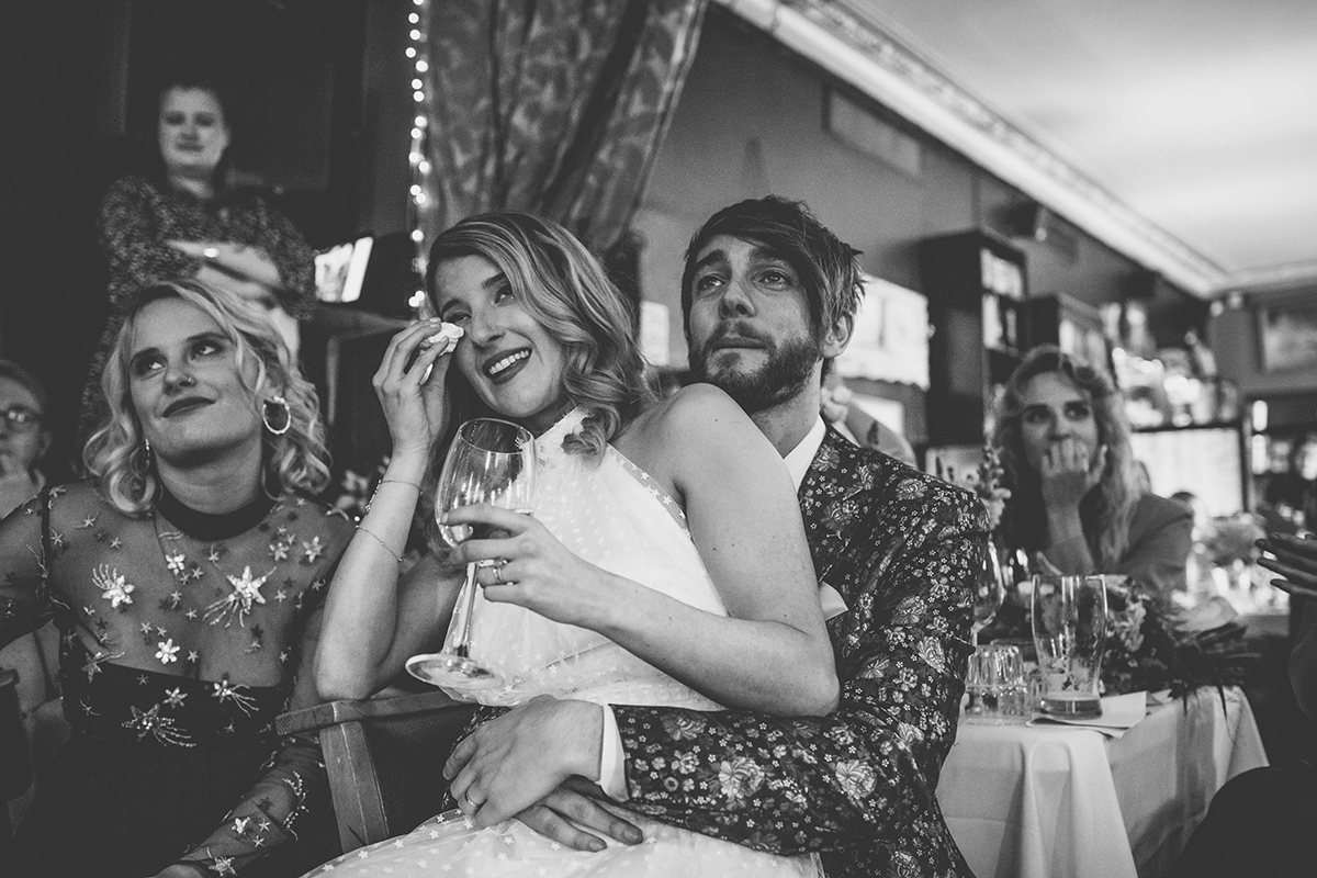 couple crying at speeches wedding photography