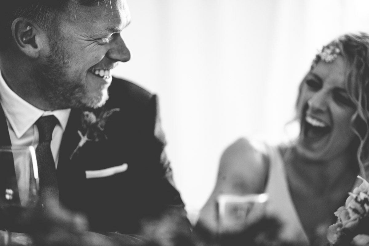 Bride and groom laughing wedding photography