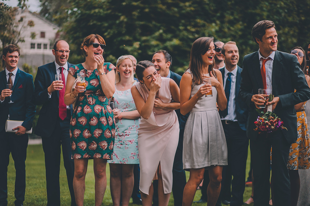 guests laughing wedding photography