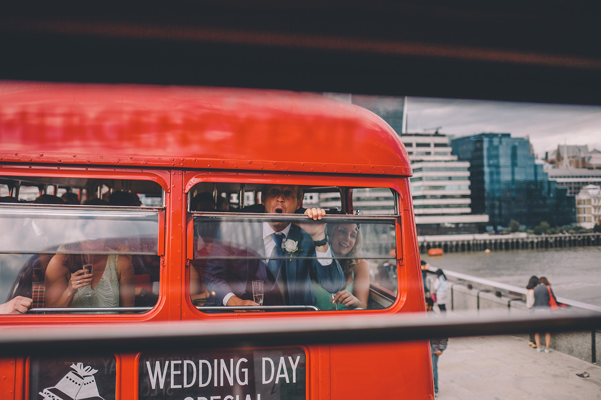 guests on bus wedding photography