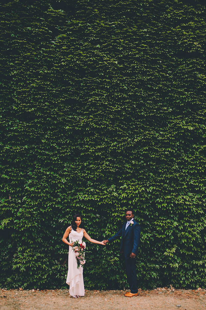 couple in front of ivy wall bride laughing in ceremony islington wedding photography