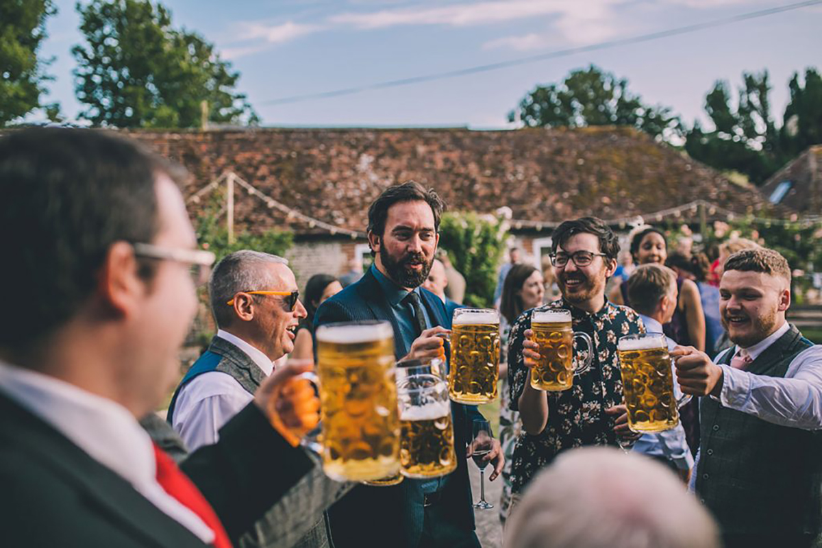 guests with beer wedding photography