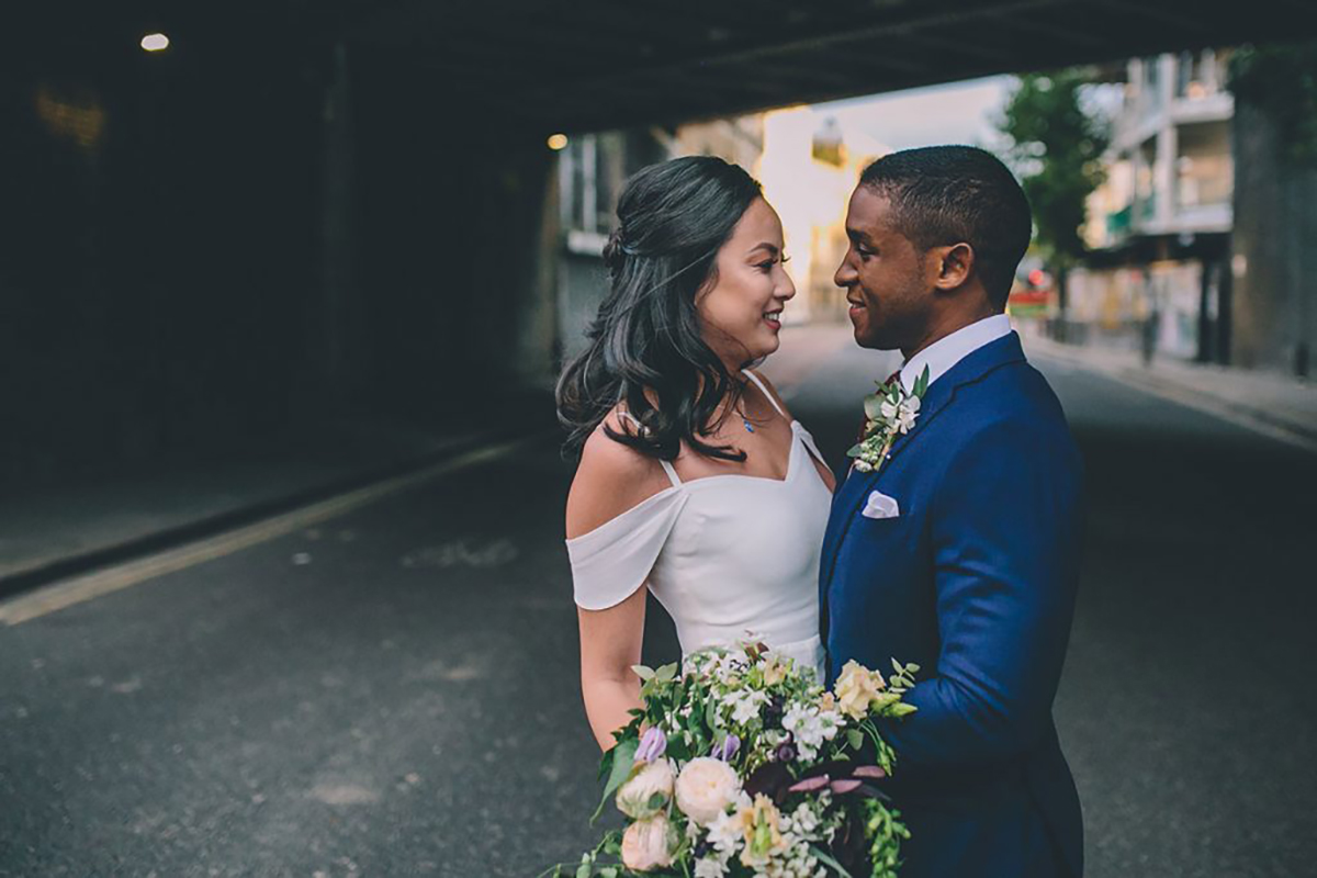 couple portrait under bridge wedding photography