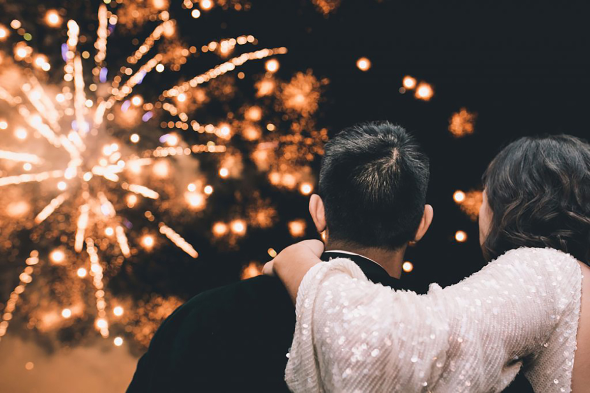 couple looking at fireworks wedding photography