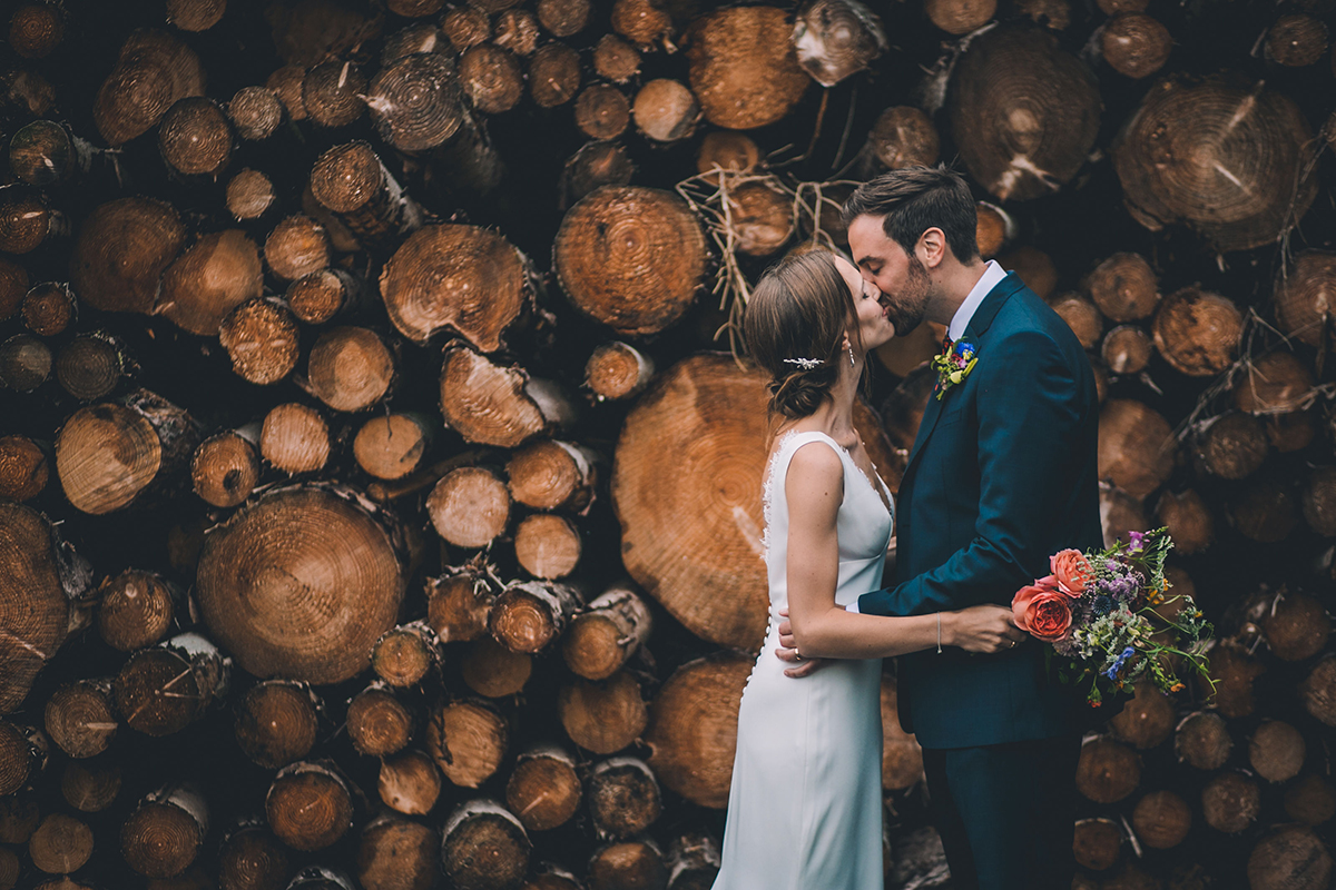 couple kissing wedding photography