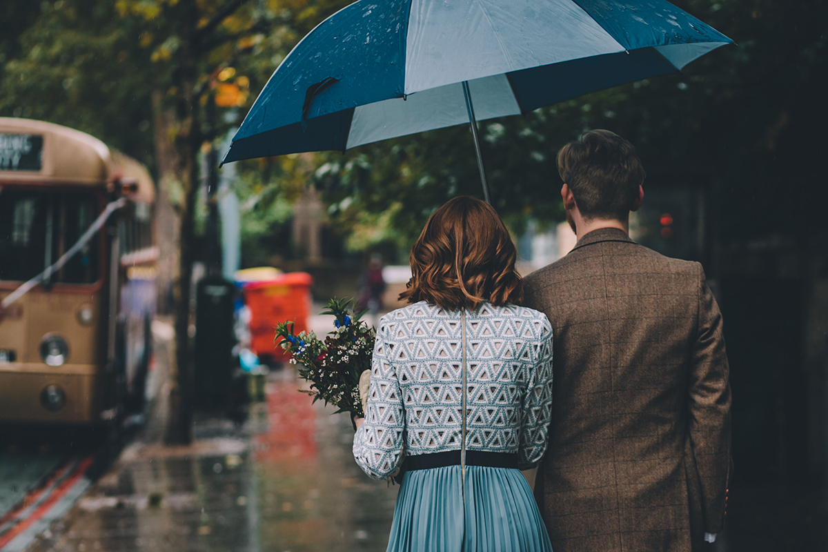 couple under umbrella wedding photography