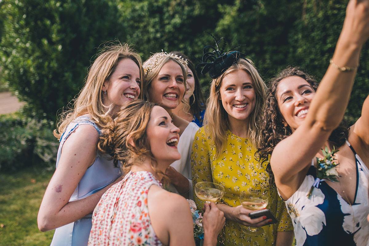 bride and friends selfie wedding photography
