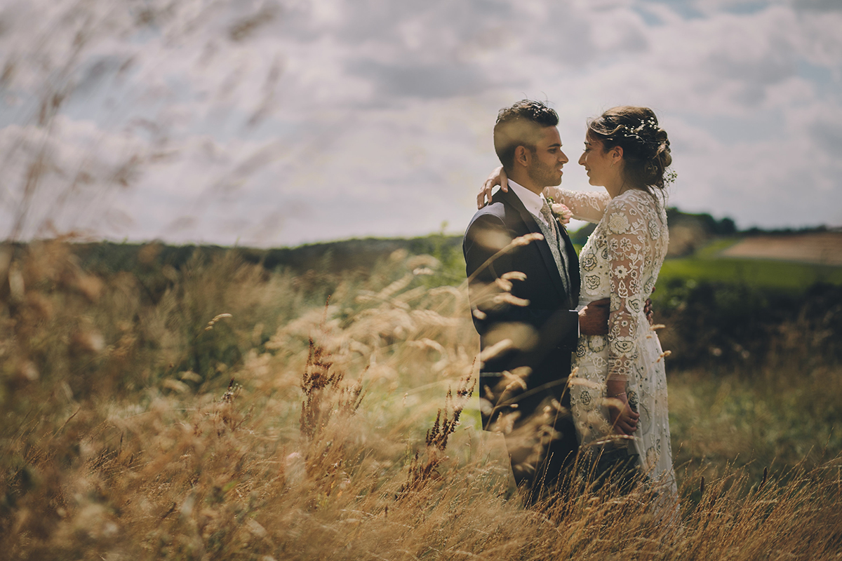 couple portrait in long grass wedding photography