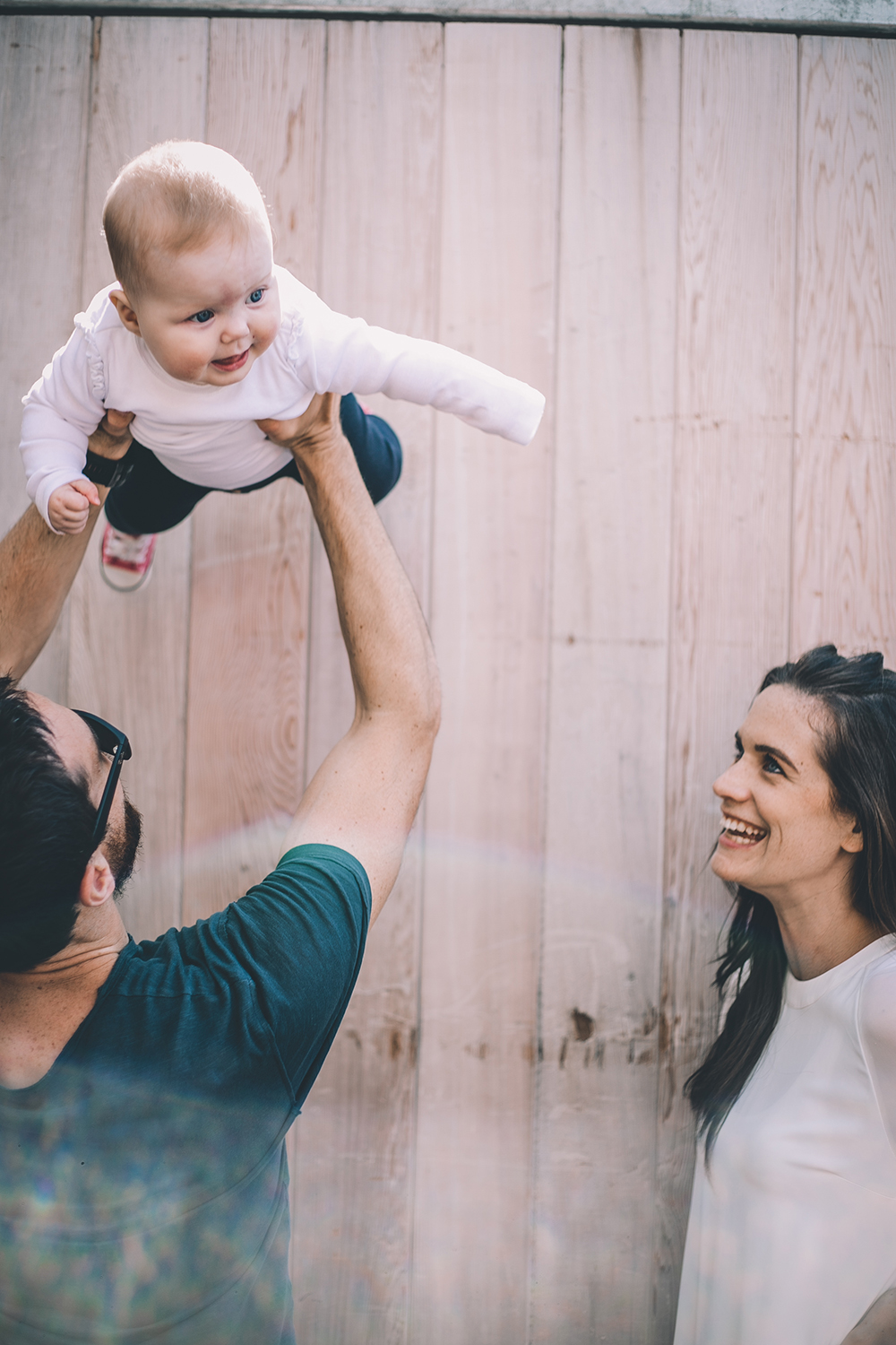family shoot baby held in air