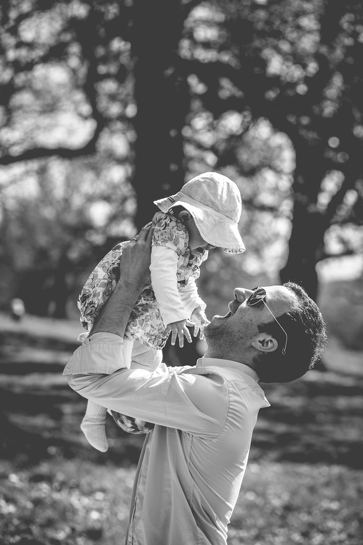 family photoshoot dad holding baby