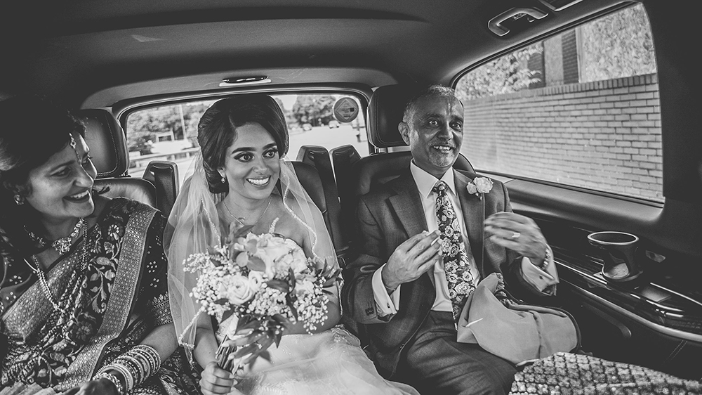 father, mother and bride in taxi
