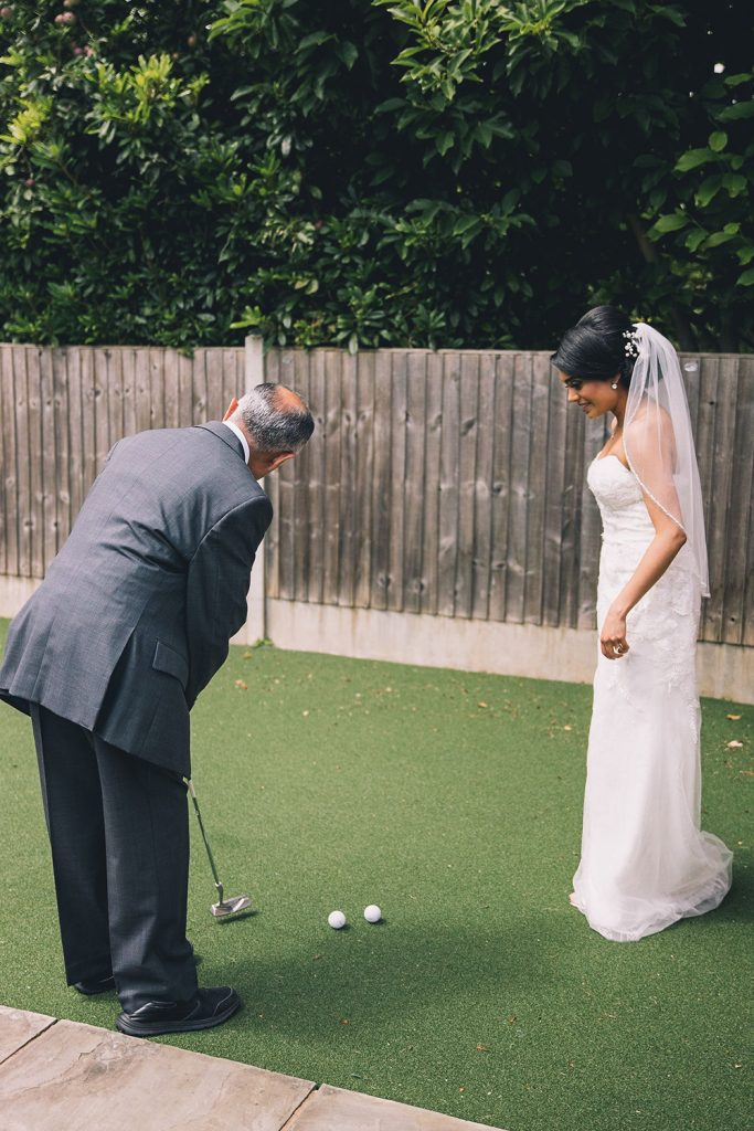 bride and father playing golf