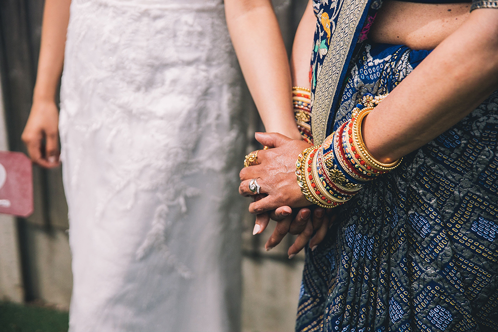 mother and bride holding hands